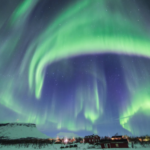 Northern lights with distinctive umbrella shape; photo attributed to Tina Tormanen, taken from Web
